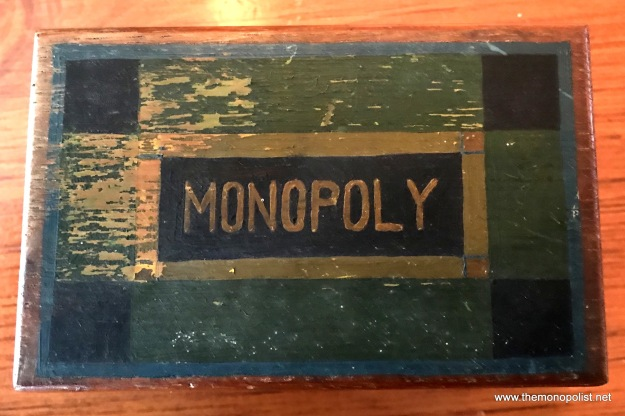The wooden utensils box identifies this game as Monopoly.