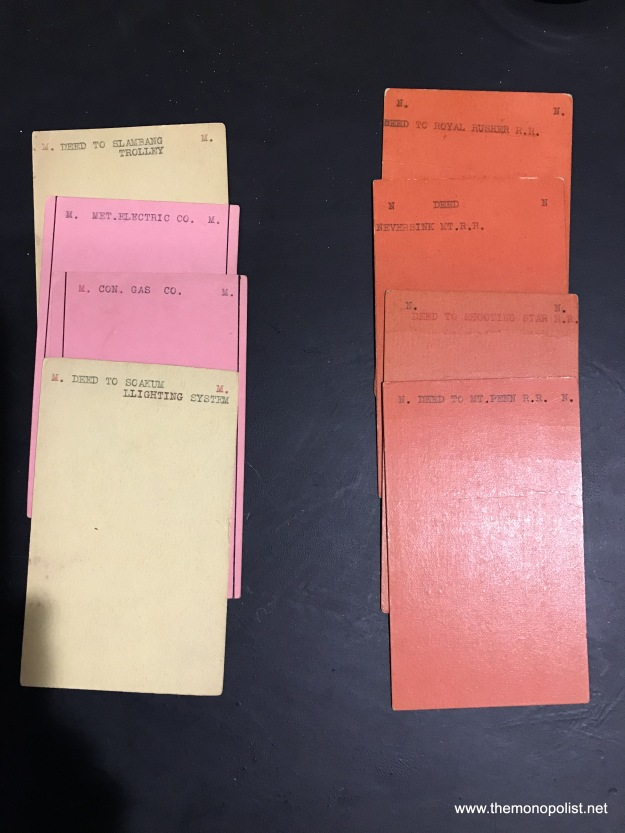 The backs of some of the property cards.